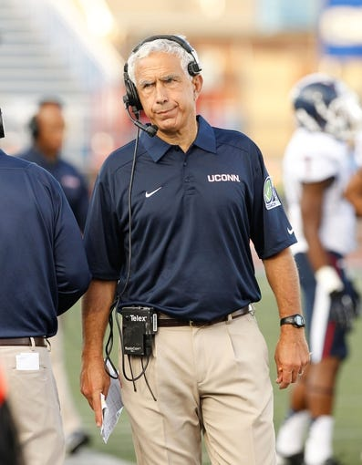 Sep 28, 2013; Buffalo, NY, USA; Connecticut Huskies head coach Paul Pasqualoni on the sideline during the game against the Buffalo Bulls at University of Buffalo Stadium. Buffalo beat Connecticut 41-12. Mandatory Credit: Kevin Hoffman-USA TODAY Sports