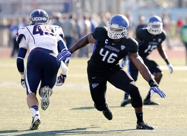Sep 28, 2013; Buffalo, NY, USA; Buffalo Bulls linebacker Khalil Mack (46) rushes past Connecticut Huskies tight end Sean McQuillan (49) at University of Buffalo Stadium. Buffalo beat Connecticut 41-12. Mandatory Credit: Kevin Hoffman-USA TODAY Sports