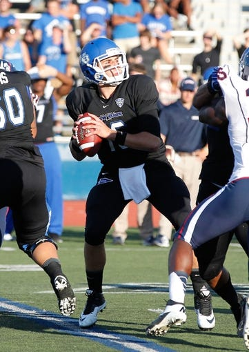 Sep 28, 2013; Buffalo, NY, USA; Buffalo Bulls quarterback Joe Licata (16) drops to pass against the Connecticut Huskies at University of Buffalo Stadium. Buffalo beat Connecticut 41-12. Mandatory Credit: Kevin Hoffman-USA TODAY Sports