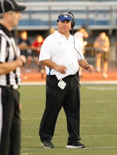 Sep 28, 2013; Buffalo, NY, USA; Buffalo Bulls head coach Jeff Quinn on the sideline during the game against the Connecticut Huskies at University of Buffalo Stadium. Buffalo beat Connecticut 41-12. Mandatory Credit: Kevin Hoffman-USA TODAY Sports