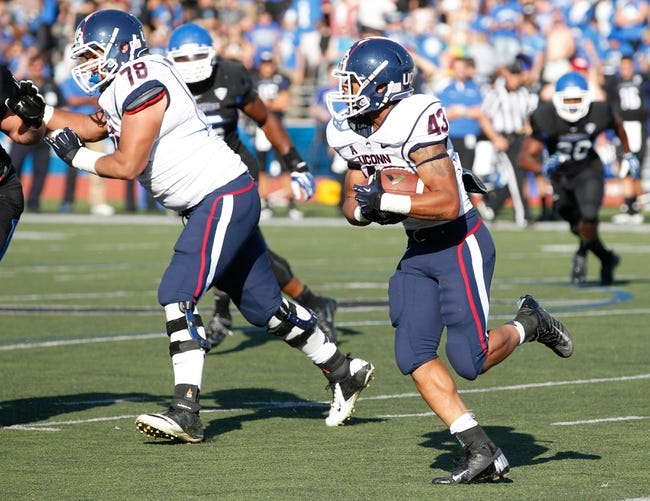 Sep 28, 2013; Buffalo, NY, USA; Connecticut Huskies running back Lyle McCombs (43) runs against the Buffalo Bulls at University of Buffalo Stadium. Buffalo beat Connecticut 41-12. Mandatory Credit: Kevin Hoffman-USA TODAY Sports