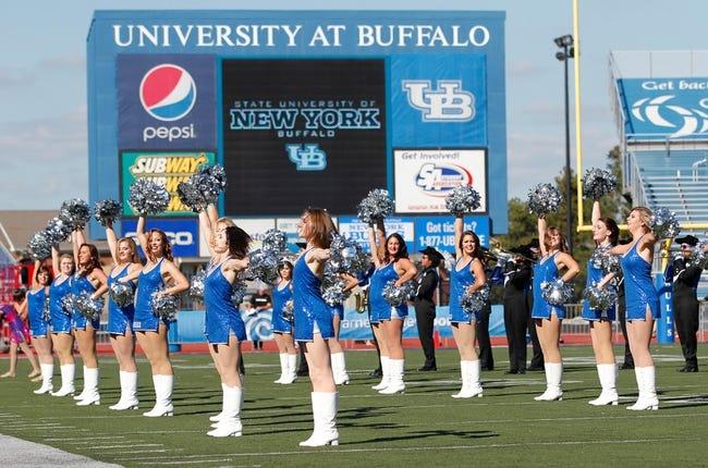 Sep 28, 2013; Buffalo, NY, USA; The Buffalo Bulls cheerleading squad performs during the game against the Connecticut Huskies at University of Buffalo Stadium. Buffalo beat Connecticut 41-12. Mandatory Credit: Kevin Hoffman-USA TODAY Sports