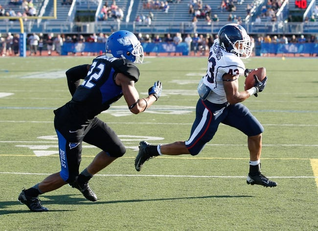 Sep 28, 2013; Buffalo, NY, USA; Buffalo Bulls defensive back Najja Johnson (22) pursues Connecticut Huskies running back Lyle McCombs (43) during the game at University of Buffalo Stadium. Buffalo beat Connecticut 41-12. Mandatory Credit: Kevin Hoffman-USA TODAY Sports
