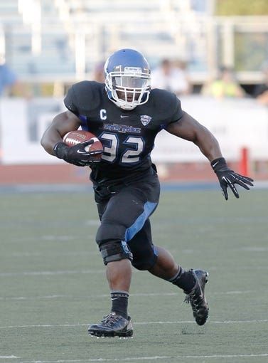 Sep 28, 2013; Buffalo, NY, USA; Buffalo Bulls running back Branden Oliver (32) runs against the Connecticut Huskies at University of Buffalo Stadium. Buffalo beat Connecticut 41-12. Mandatory Credit: Kevin Hoffman-USA TODAY Sports