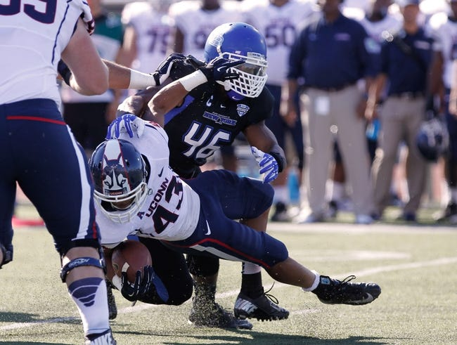 Sep 28, 2013; Buffalo, NY, USA; Buffalo Bulls linebacker Khalil Mack (46) tackles Connecticut Huskies running back Lyle McCombs (43) during the game at University of Buffalo Stadium. Buffalo beat Connecticut 41-12. Mandatory Credit: Kevin Hoffman-USA TODAY Sports