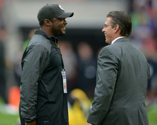 Sep 29, 2013; London, UNITED KINGDOM; Pittsburgh Steelers coach Mike Tomlin (left) and Minnesota Vikings general manager Rick Spielman before the NFL International Series game at Wembley Stadium. The Vikings defeated the Steelers 34-27. Mandatory Credit: Kirby Lee-USA TODAY Sports