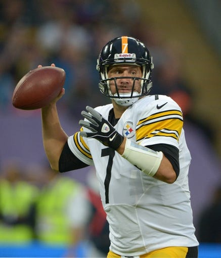 Sep 29, 2013; London, UNITED KINGDOM; Pittsburgh Steelers quarterback Ben Roethlisberger (7) throws a pass against the Minnesota Vikings in the NFL International Series game at Wembley Stadium. Mandatory Credit: Kirby Lee-USA TODAY Sports
