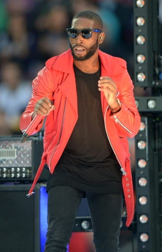 Sep 29, 2013; London, UNITED KINGDOM; Recording artist Tinie Tempah performs before the NFL International Series game between the Pittsburgh Steelers and the Minnesota Vikings at Wembley Stadium.  Mandatory Credit: Kirby Lee-USA TODAY Sports