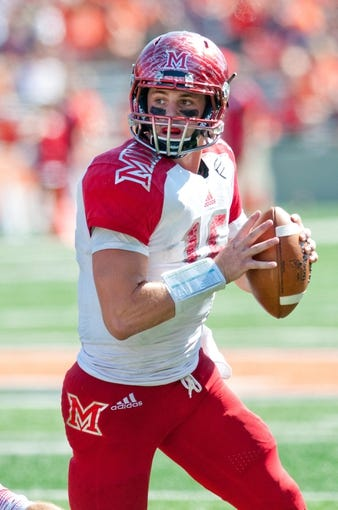 Sep 28, 2013; Champaign, IL, USA; Miami (Oh) Redhawks quarterback Austin Boucher (16) looks for a receiver during the game against the Illinois Fighting Illini at Memorial Stadium. Mandatory Credit: Bradley Leeb-USA TODAY Sports
