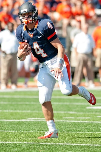 Sep 28, 2013; Champaign, IL, USA; Illinois Fighting Illini quarterback Reilly O'Toole (4) runs the ball during the game against the Miami (OH) Redhawks at Memorial Stadium. Mandatory Credit: Bradley Leeb-USA TODAY Sports