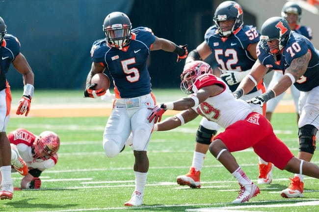 Sep 28, 2013; Champaign, IL, USA; Illinois Fighting Illini running back Donovonn Young (5) runs the ball during the game against the Miami (OH) Redhawks at Memorial Stadium. Mandatory Credit: Bradley Leeb-USA TODAY Sports