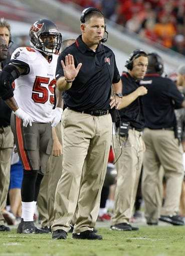 Sep 15, 2013; Tampa, FL, USA; Tampa Bay Buccaneers head coach Greg Schiano calls a play against the New Orleans Saints during the first half at Raymond James Stadium. Mandatory Credit: Kim Klement-USA TODAY Sports