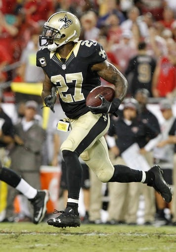 Sep 15, 2013; Tampa, FL, USA; New Orleans Saints free safety Malcolm Jenkins (27) intercepts the ball during the second half against the Tampa Bay Buccaneers at Raymond James Stadium. New Orleans Saints defeated the Tampa Bay Buccaneers 16-14. Mandatory Credit: Kim Klement-USA TODAY Sports