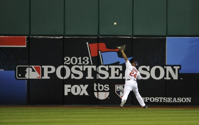 Oct 2, 2013; Cleveland, OH, USA; Cleveland Indians center fielder Michael Bourn (24) catches a deep fly ball by Tampa Bay Rays left fielder David DeJesus (not pictured) during the first inning in the American League wild card playoff game at Progressive Field. Mandatory Credit: David Richard-USA TODAY Sports