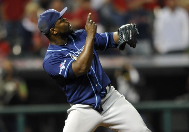 Oct 2, 2013; Cleveland, OH, USA; Tampa Bay Rays relief pitcher Fernando Rodney (56) celebrates after defeating the Cleveland Indians in the American League wild card playoff game at Progressive Field. Tampa Bay won 4-0. Mandatory Credit: David Richard-USA TODAY Sports