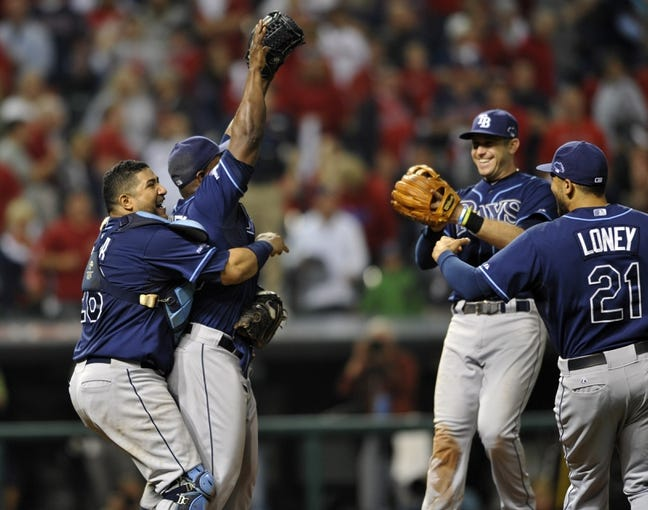 Oct 2, 2013; Cleveland, OH, USA; Tampa Bay Rays relief pitcher Fernando Rodney (56) and catcher Jose Molina (left) celebrates after defeating the Cleveland Indians in the American League wild card playoff game at Progressive Field. Tampa Bay won 4-0. Mandatory Credit: David Richard-USA TODAY Sports