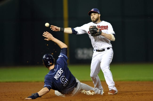 Oct 2, 2013; Cleveland, OH, USA; Cleveland Indians second baseman Jason Kipnis (22) turns a double play over Tampa Bay Rays right fielder Wil Myers (9) during the eighth inning in the American League wild card playoff game at Progressive Field. Mandatory Credit: David Richard-USA TODAY Sports