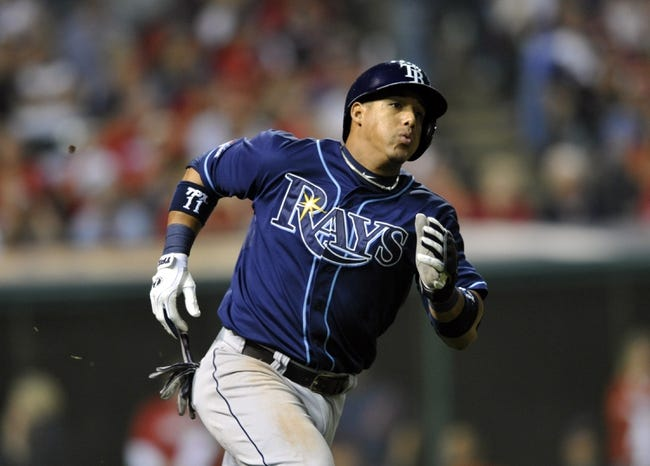 Oct 2, 2013; Cleveland, OH, USA; Tampa Bay Rays shortstop Yunel Escobar (11) runs out an RBI single against the Cleveland Indians during the 9th inning in the American League wild card playoff game at Progressive Field. Mandatory Credit: David Richard-USA TODAY Sports