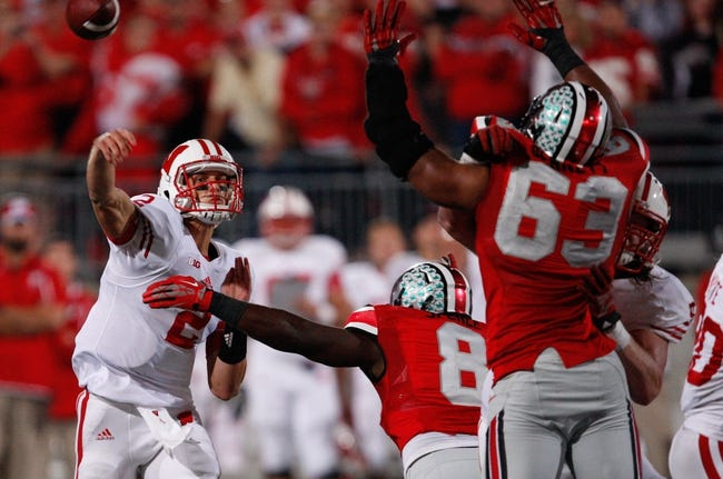 Sep 28, 2013; Columbus, OH, USA; Wisconsin Badgers quarterback Joel Stave (2) throws the ball during the fourth quarter against the Ohio State Buckeyes at Ohio Stadium. Buckeyes beat the Badgers 31-24. Mandatory Credit: Raj Mehta-USA TODAY Sports