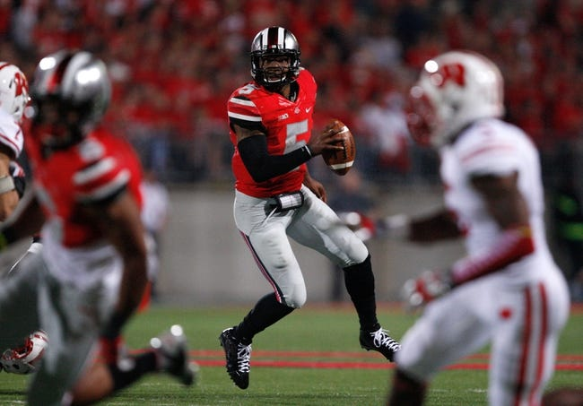 Sep 28, 2013; Columbus, OH, USA; Ohio State Buckeyes quarterback Braxton Miller (5) looks down the field during the third quarter against the Wisconsin Badgers at Ohio Stadium. Buckeyes beat the Badgers 31-24. Mandatory Credit: Raj Mehta-USA TODAY Sports