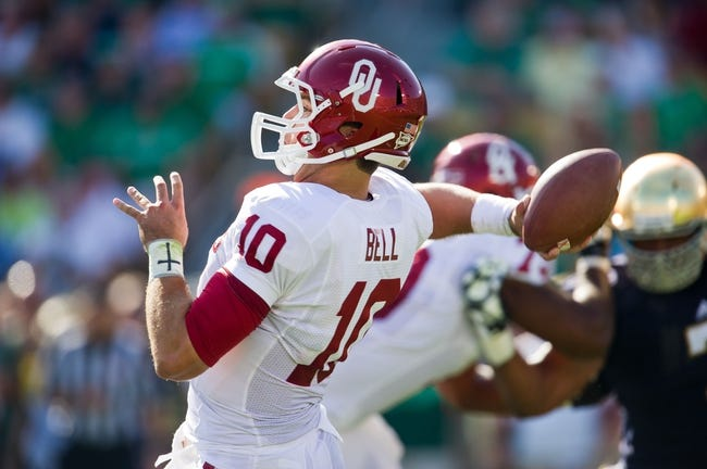 Sep 28, 2013; South Bend, IN, USA; Oklahoma Sooners quarterback Blake Bell (10) throws in the first quarter against the Notre Dame Fighting Irish at Notre Dame Stadium. Oklahoma won 35-21. Mandatory Credit: Matt Cashore-USA TODAY Sports