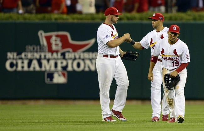 Oct 3, 2013; St. Louis, MO, USA; St. Louis Cardinals left fielder Matt Holliday (left), right fielder Carlos Beltran (middle) and center fielder Jon Jay (19) celebrate after defeating the Pittsburgh Pirates in game one of the National League divisional series playoff baseball game at Busch Stadium. St. Louis defeated Pittsburgh 9-1. Mandatory Credit: Jeff Curry-USA TODAY Sports