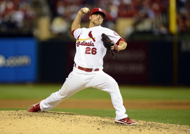 Oct 3, 2013; St. Louis, MO, USA; St. Louis Cardinals relief pitcher Trevor Rosenthal (26) throws to a Pittsburgh Pirates batter during the ninth inning in game one of the National League divisional series playoff baseball game at Busch Stadium. St. Louis defeated Pittsburgh 9-1. Mandatory Credit: Jeff Curry-USA TODAY Sports