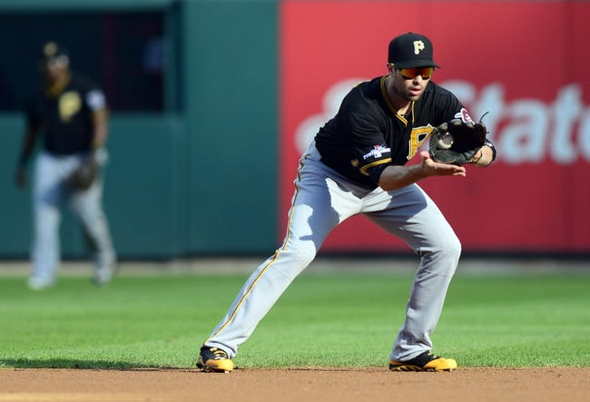 Oct 3, 2013; St. Louis, MO, USA; Pittsburgh Pirates second baseman Neil Walker (18) fields a ground ball hit by St. Louis Cardinals first baseman Matt Adams (not pictured) during the first inning in game one of the National League divisional series playoff baseball game at Busch Stadium. St. Louis defeated Pittsburgh 9-1. Mandatory Credit: Jeff Curry-USA TODAY Sports