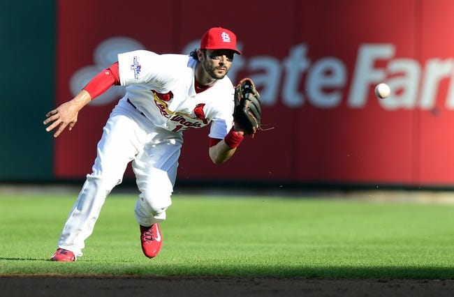 Oct 3, 2013; St. Louis, MO, USA; St. Louis Cardinals second baseman Matt Carpenter (13) fields ground ball hit by Pittsburgh Pirates first baseman Justin Morneau (not pictured) during the second inning in game one of the National League divisional series playoff baseball game at Busch Stadium. St. Louis defeated Pittsburgh 9-1. Mandatory Credit: Jeff Curry-USA TODAY Sports