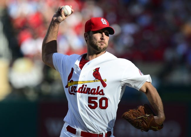 Oct 3, 2013; St. Louis, MO, USA; St. Louis Cardinals starting pitcher Adam Wainwright (50) throws to a Pittsburgh Pirates batter during the second inning in game one of the National League divisional series playoff baseball game at Busch Stadium. St. Louis defeated Pittsburgh 9-1. Mandatory Credit: Jeff Curry-USA TODAY Sports
