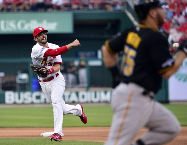 Oct 3, 2013; St. Louis, MO, USA; St. Louis Cardinals second baseman Matt Carpenter (13) throws out Pittsburgh Pirates catcher Russell Martin (55) in game one of the National League divisional series playoff baseball game at Busch Stadium. The Cardinals defeated the Pirates 9-1. Mandatory Credit: Scott Rovak-USA TODAY Sports