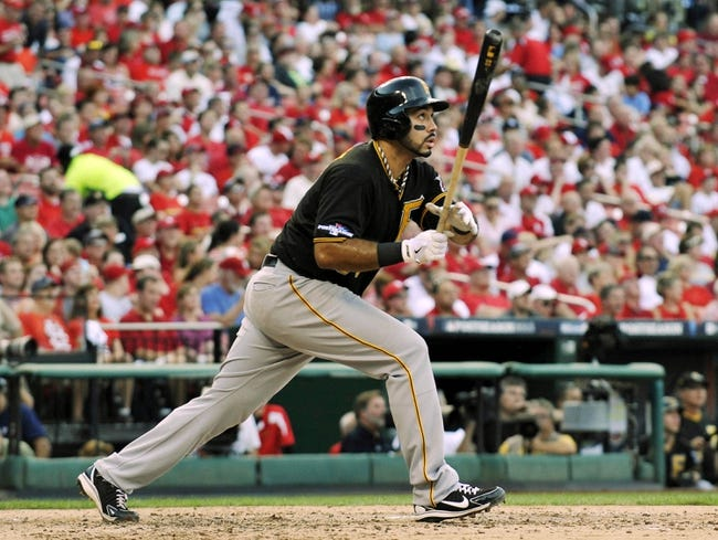 Oct 3, 2013; St. Louis, MO, USA; Pittsburgh Pirates third baseman Pedro Alvarez (24) hits a solo home run against the St. Louis Cardinals in the fifth inning of game one of the National League divisional series playoff baseball game at Busch Stadium. The Cardinals defeated the Pirates 9-1. Mandatory Credit: Scott Rovak-USA TODAY Sports