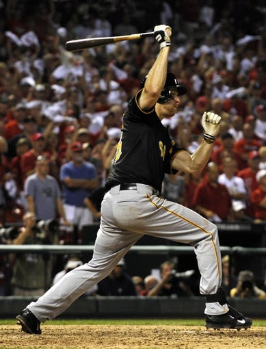 Oct 3, 2013; St. Louis, MO, USA; Pittsburgh Pirates first baseman Justin Morneau (66) grounds out to end the game against the St. Louis Cardinals in game one of the National League divisional series playoff baseball game at Busch Stadium. The Cardinals defeated the Pirates 9-1. Mandatory Credit: Scott Rovak-USA TODAY Sports