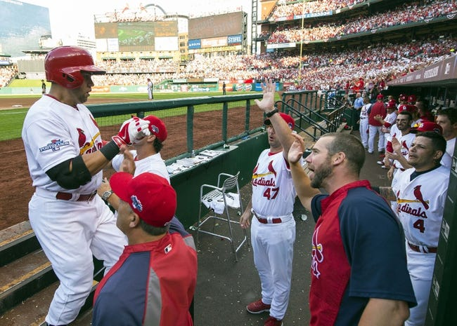 Oct 3, 2013; St. Louis, MO, USA; St. Louis Cardinals right fielder Carlos Beltran (left) is welcomed back to the dugout after hitting a three-run home run in the third inning against the Pittsburgh Pirates in game one of the National League divisional series playoff baseball game at Busch Stadium. The Cardinals derated the Pirates 9-1. Mandatory Credit: Scott Rovak-USA TODAY Sports