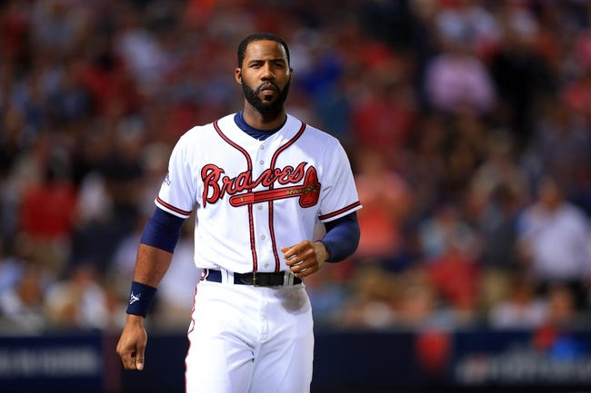 Oct 3, 2013; Atlanta, GA, USA; Atlanta Braves center fielder Jason Heyward (22) reacts after striking out against the Los Angeles Dodgers during the fifth inning of game one of the National League divisional series playoff baseball game at Turner Field. Mandatory Credit: Daniel Shirey-USA TODAY Sports