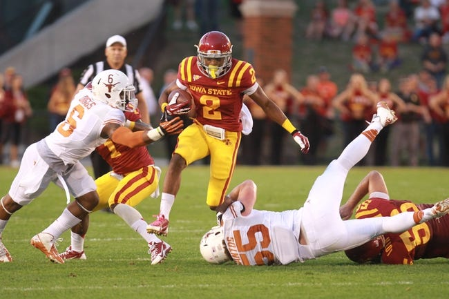 Oct 3, 2013; Ames, IA, USA; Texas Longhorns linebacker Dalton Santos (55)is hurdled by Iowa State Cyclones running back James White (8) during the second quarter at Jack Trice Stadium. Mandatory Credit: Reese Strickland-USA TODAY Sports