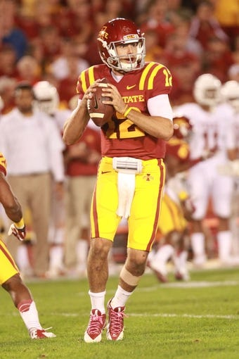 Oct 3, 2013; Ames, IA, USA; Iowa State Cyclones quarter back Sam Richardson (12) looks down field against the Texas Longhorns during the second quarter at Jack Trice Stadium. Mandatory Credit: Reese Strickland-USA TODAY Sports