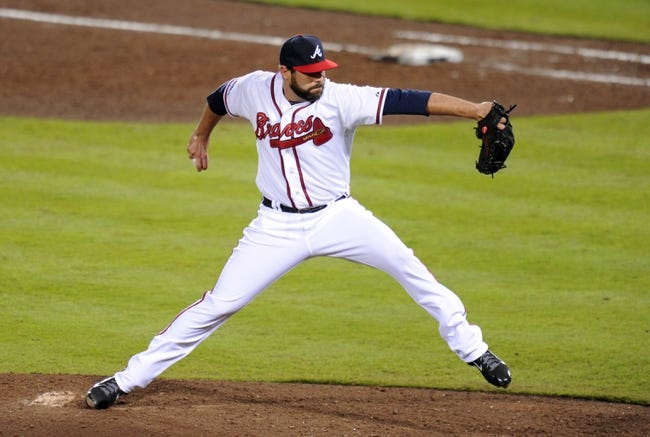 Oct 3, 2013; Atlanta, GA, USA; Atlanta Braves relief pitcher Jordan Walden (52) throws against the Los Angeles Dodgers during the sixth inning of game one of the National League divisional series playoff baseball game at Turner Field. Mandatory Credit: Dale Zanine-USA TODAY Sports