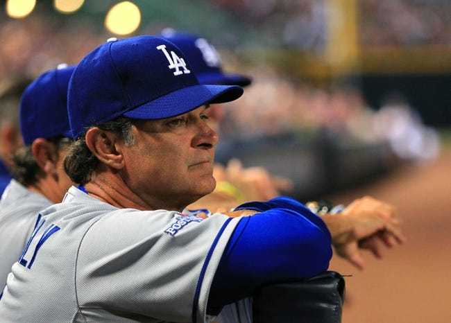 Oct 3, 2013; Atlanta, GA, USA; Los Angeles Dodgers manager Don Mattingly (8) looks on during game one of the National League divisional series playoff baseball game against the Atlanta Braves at Turner Field. Mandatory Credit: Daniel Shirey-USA TODAY Sports