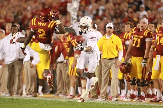 Oct 3, 2013; Ames, IA, USA; Texas Longhorns receiver Shiro Davis (1) goes for a pass over Iowa State Cyclones corner Jansen Watson (2) at Jack Trice Stadium. Texas beat Iowa State 31-30.   Mandatory Credit: Reese Strickland-USA TODAY Sports