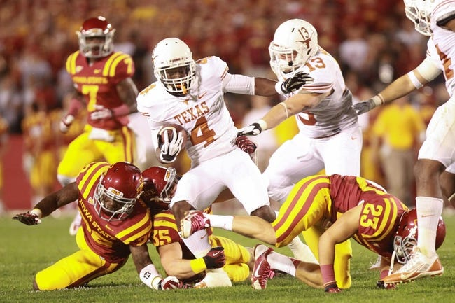 Oct 3, 2013; Ames, IA, USA; Texas Longhorns receiver Daje Johnson (4) is tackled by Iowa State Cyclones safety Deon Broomfield (26), linebacker Levi Peters (35) and cornerback Darian Cotton (23) during the fourth quarter at Jack Trice Stadium. Texas beat Iowa State 31-30.   Mandatory Credit: Reese Strickland-USA TODAY Sports