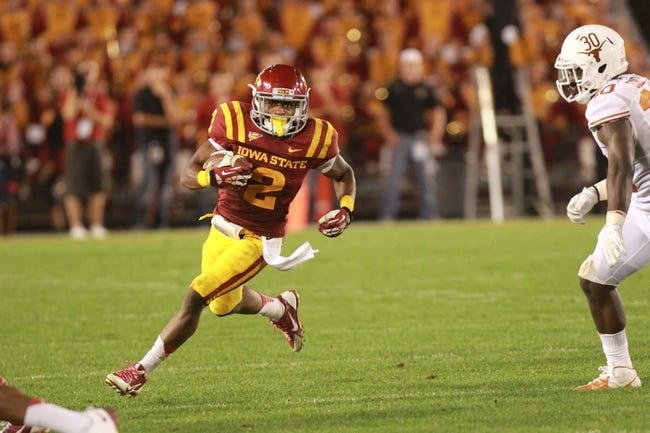 Oct 3, 2013; Ames, IA, USA;  Iowa State Cyclones running back Aaron Wimberly (2) runs past the Texas Longhorns  linebacker Timothy Cole (30) during the fourth quarter at Jack Trice Stadium. Texas beat Iowa State 31-30.   Mandatory Credit: Reese Strickland-USA TODAY Sports