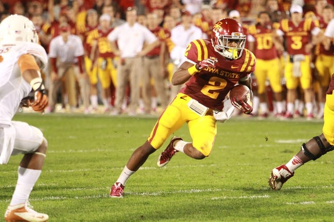 Oct 3, 2013; Ames, IA, USA;  Iowa State Cyclones running back Aaron Wimberly (2) runs against the Texas Longhorns  during the fourth quarter at Jack Trice Stadium. Texas beat Iowa State 31-30.   Mandatory Credit: Reese Strickland-USA TODAY Sports