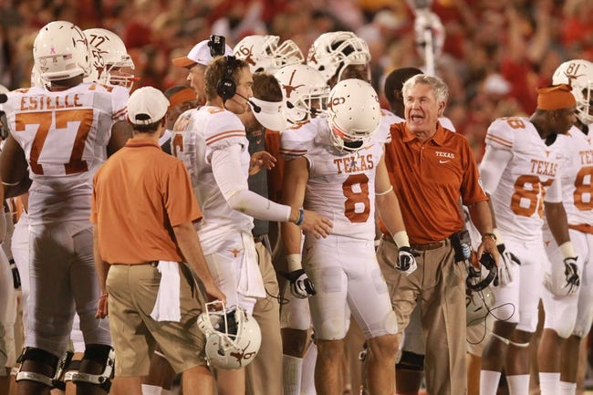 Oct 3, 2013; Ames, IA, USA; Texas Longhorns coach Mack Brown tries to motivate receiver Jaxon Shipley (8) during the fourth quarter of the Iowa State Cyclones game at Jack Trice Stadium. Texas beat Iowa State 31-30.   Mandatory Credit: Reese Strickland-USA TODAY Sports