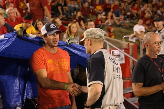 Oct 3, 2013; Ames, IA, USA; Minnesota Vikings quarterback Christian Ponder shakes hands with a military volunteer during the Iowa State Cyclones vs Texas Longhorns game at Jack Trice Stadium. Texas Beat Iowa State 31-30.  Mandatory Credit: Reese Strickland-USA TODAY Sports