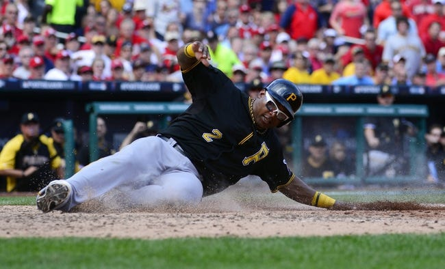 Oct 4, 2013; St. Louis, MO, USA; Pittsburgh Pirates right fielder Marlon Byrd scores a run against the St. Louis Cardinals in the seventh inning in game two of the National League divisional series playoff baseball game at Busch Stadium. Mandatory Credit: Scott Rovak-USA TODAY Sports