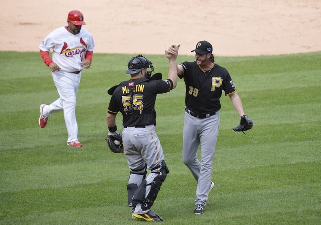 Oct 4, 2013; St. Louis, MO, USA; Pittsburgh Pirates relief pitcher Jason Grilli (39) shakes hands with catcher Russell Martin (55) after game two of the National League divisional series playoff baseball game against the St. Louis Cardinals at Busch Stadium. Mandatory Credit: Jasen Vinlove-USA TODAY Sports