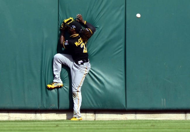 Oct 4, 2013; St. Louis, MO, USA; Pittsburgh Pirates center fielder Andrew McCutchen (22) crashes into the wall while chasing a fly ball in the 9th inning in game two of the National League divisional series playoff baseball game against the St. Louis Cardinals at Busch Stadium. Mandatory Credit: Jeff Curry-USA TODAY Sports