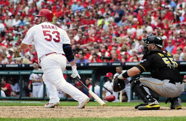 Oct 4, 2013; St. Louis, MO, USA; St. Louis Cardinals first baseman Matt Adams (53) hits a single off of Pittsburgh Pirates relief pitcher Tony Watson (not pictured) during the seventh inning in game two of the National League divisional series playoff baseball game at Busch Stadium. Pittsburgh defeated St. Louis 7-1. Mandatory Credit: Jeff Curry-USA TODAY Sports