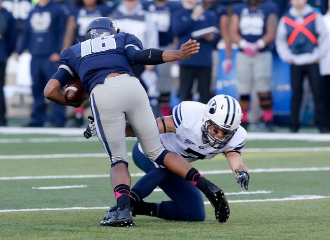 Oct 4, 2013; Logan, UT, USA; Brigham Young Cougars defensive back Skye PoVey (7) tackles Utah State Aggies quarterback Chuckie Keeton (16) during the first quarter at Romney Stadium. Mandatory Credit: Chris Nicoll-USA TODAY Sports
